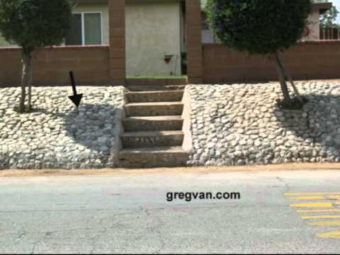 Landscaping tips sloped rock and concrete erosion for Landscaping rocks on a hill