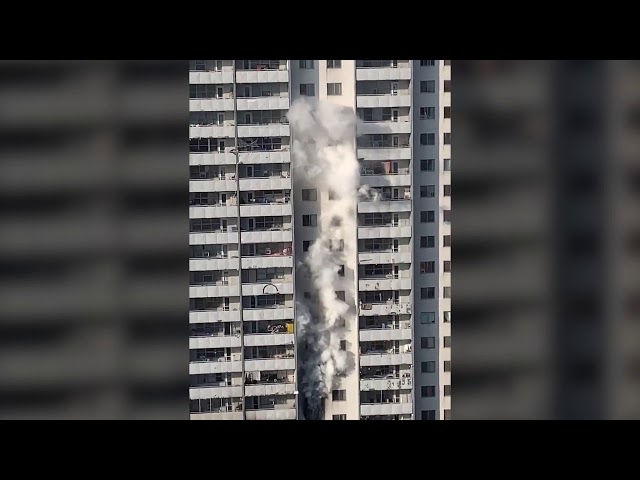 A video posted to Twitter Friday morning shows white smoke billowing out of a ninth-floor window.