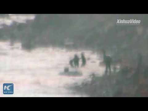 Police officer risks life to save drowning migrant