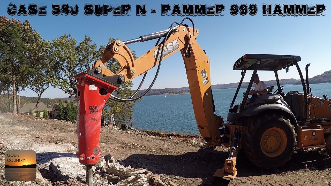 Case 580 Backhoe >> Case 580 Super N Backhoe and Rammer 999 Hammer Breaking Rock - YouTube