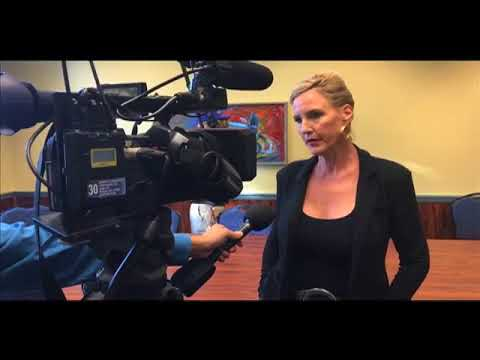 Erin Brockovich speaks to the local media before a GenX Forum at UNCW's Lumina Theater