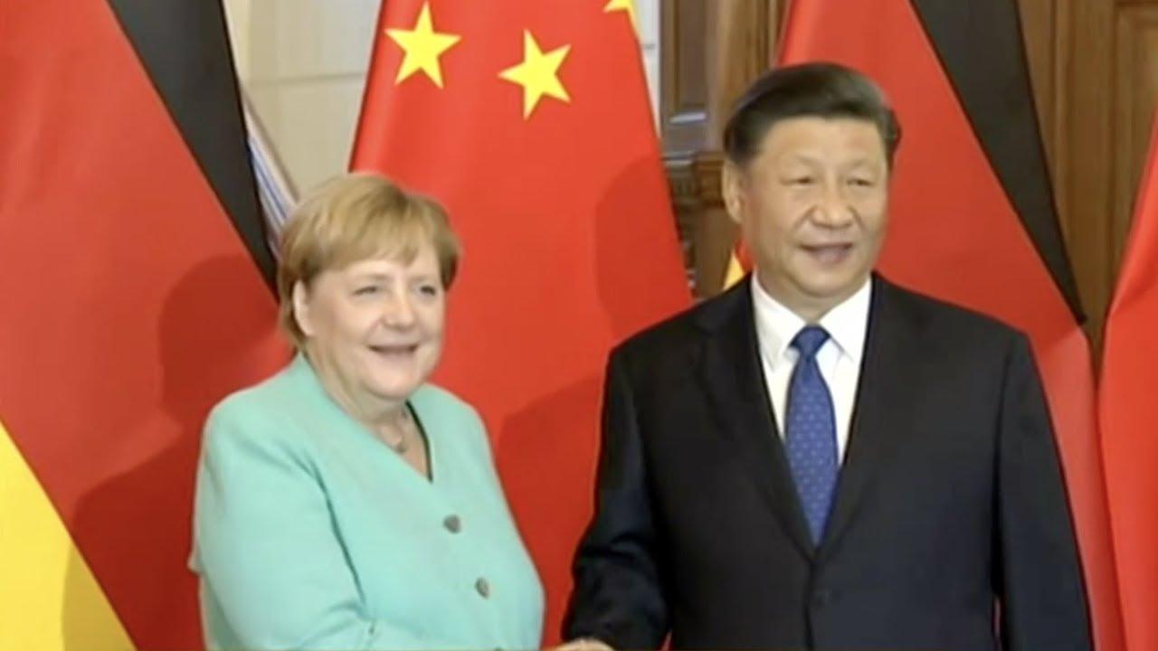 Xi Jinping meets with Angela Merkel in Beijing - YouTube