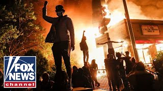 Minneapolis protesters burn down police precinct as tensions escalate