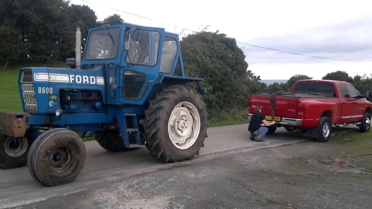 dodge ram cummins vs ford 8600 tractor tug of war  YouTube