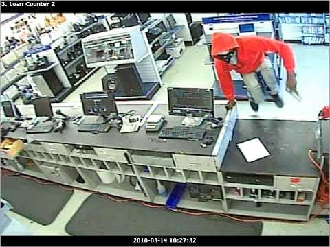 Watch armed man rob Gentilly pawn shopof cash, guns