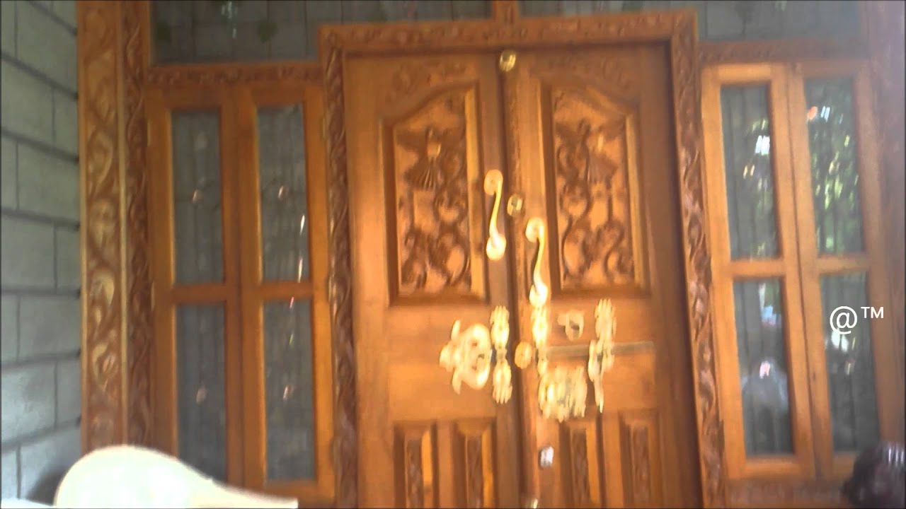 Kerala style beautiful front door for house youtube for Decorative main door designs