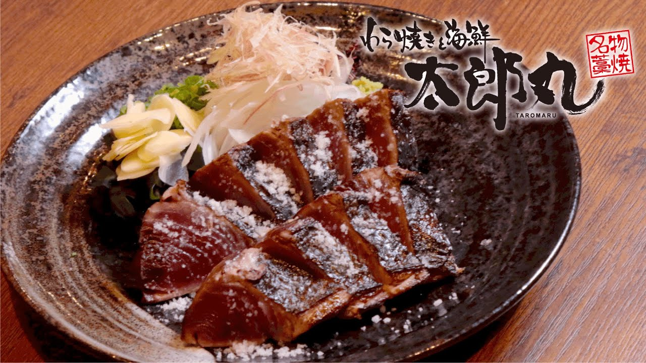 Enjoy fresh fish dishes in a houseboat-style izakaya