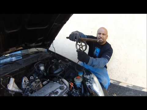 HOW TO TAKE OFF A CYLINDER HEAD W/OUT TAKING OFF THE TIMING BELT BEST TIME & MONEY SAVER TIP EVER