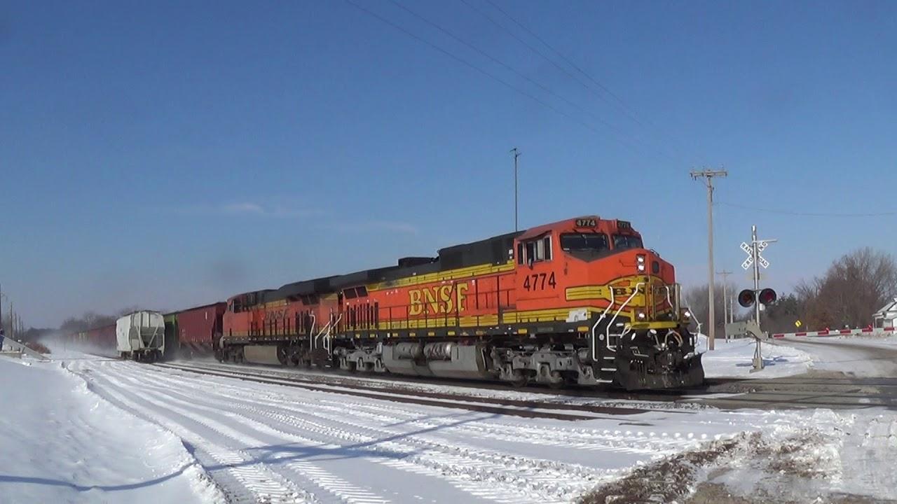 Lots of BN Hoppers on BNSF Train in Snowy Iowa