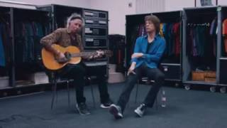 Mick Jagger and Keith Richards perform an acoustic version of their...