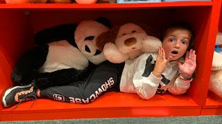 Playing Hide and Seak in toy store