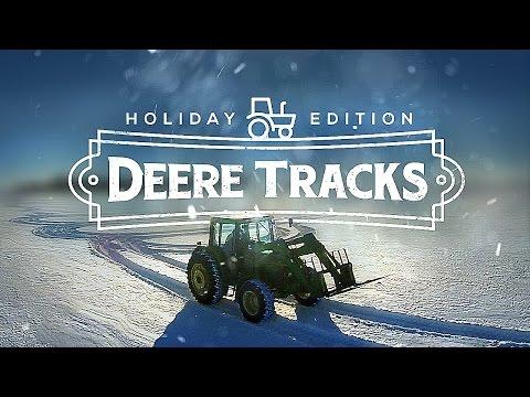 DeereTracks | Christmas Edition - FARMER CREATES AMAZING SNOW ART WITH TRACTOR & DRONE