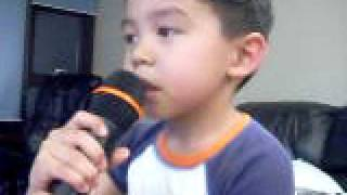 "My 5yr old son, singing Karaoke version of  ""So What"" by Pink"