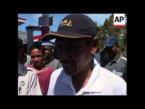 Survivors search homes, demolition, queues for supplies