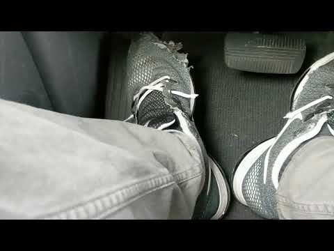 driving-in-trashed-nike-high-tops-and-zoom-all-out-running-shoes