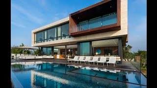 Contemporary House Design With Clean and Simple Wood and Travertine Façade