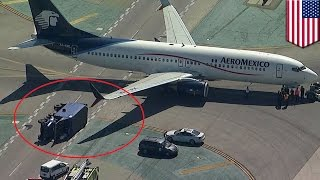 Aeromexico plane crashes into supply truck on LAX taxiway, eight injured   TomoNews