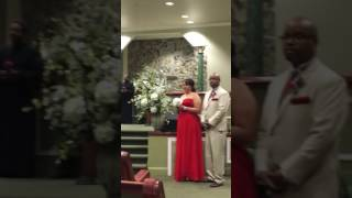Jasmine Stamps singing at wedding