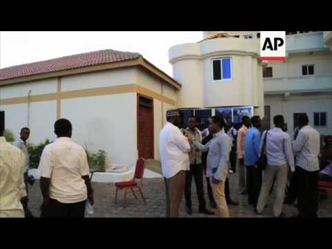 Somalia's first ever cash machine opens for business in Mogadishu