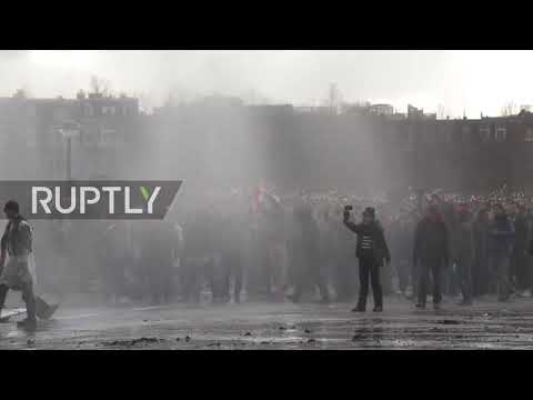 Netherlands: Police clash with protesters as thousands rally against COVID lockdown in Amsterdam