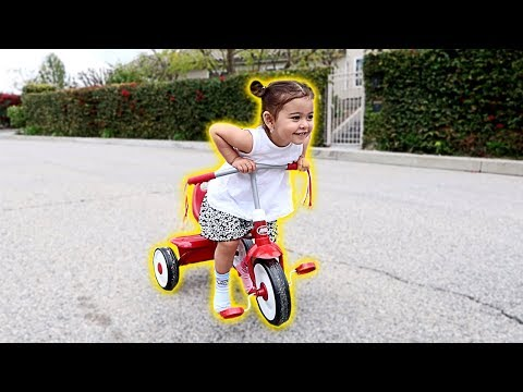 ELLE LEARNS HOW TO RIDE A BIKE!!! (WE CAN'T BELIEVE IT)
