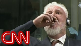 War criminal drinks poison during sentencing