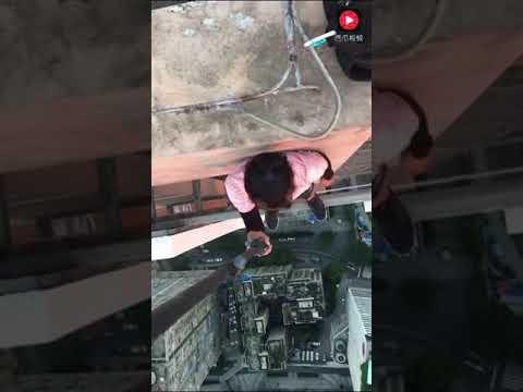 A brave man climb on high building