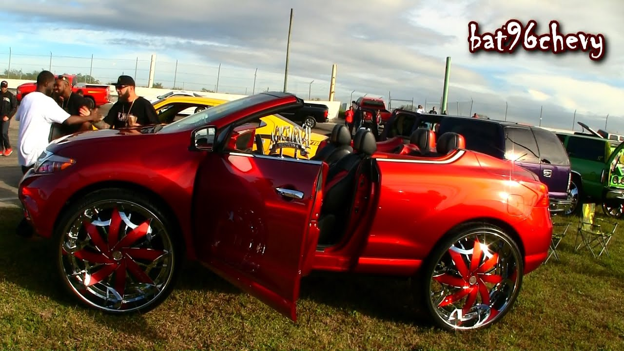 "female's candy red nissan murano convertible on 32"" amani forged"