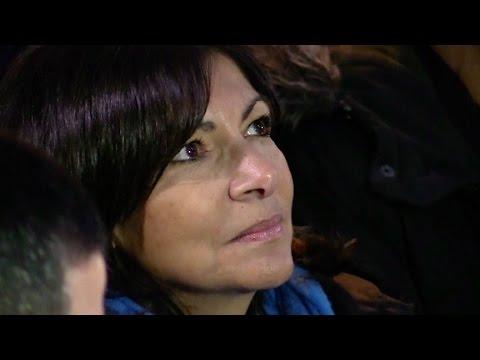 Paris Mayor Anne Hidalgo enlightens Place de la République during hommage in Paris.