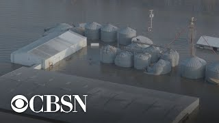 Historic snow storm hits regions devastated by historic flooding along the Missouri River last mo…