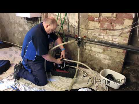 Plumber Doing A Magnacleanse Day In The Life Of A Plumbing  / Gas Engineer