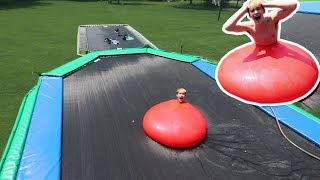 WORLDS BIGGEST WATER BALLOON VS WORLDS BIGGEST TRAMPOLINE!
