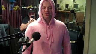 Jim Norton tries on the pink Hoodie Footie Snuggle suit