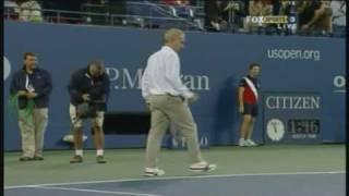 Novak Djokovic and John McEnroe having a hit