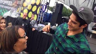 Tyler Posey hugs a fan at the 2016 EW Pop Fest