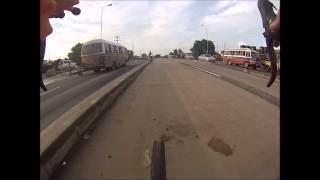 Rollerbladers hanging onto 90km/h buses, Dar es Salaam, Tanzan…