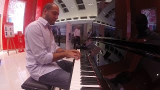 Repeat youtube video Amazing Pianist surprises people at a mall.
