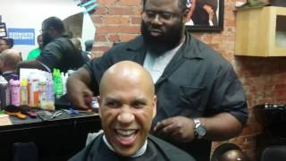Cory Booker campaigns for Hillary Clinton while getting a hair cut