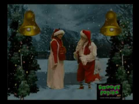 Santa and Mrs. Claus having fun with...