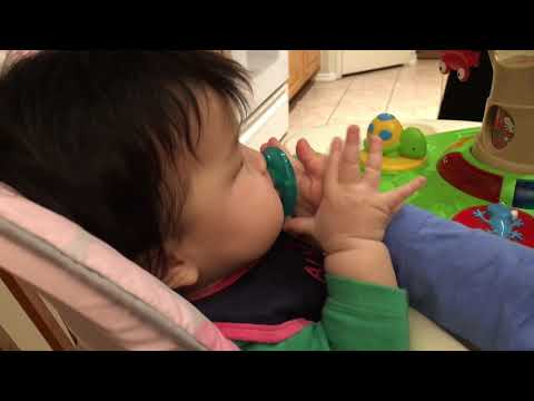 Toddler Charlotte loves helping with baby Natalie with her toys and Wubbanub Pacifier