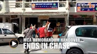 MCA memorandum handover ends in chase after 'gift' from DAP rejected