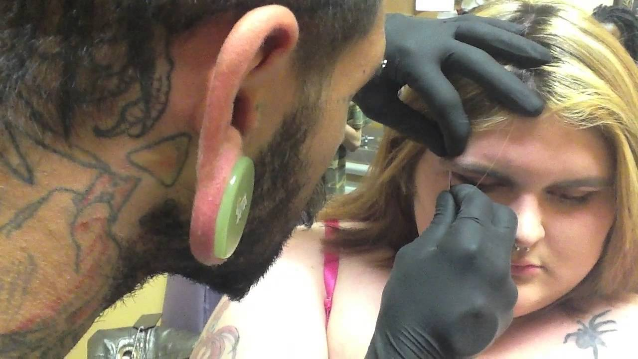 How an eyebrow piercing is done! - YouTube