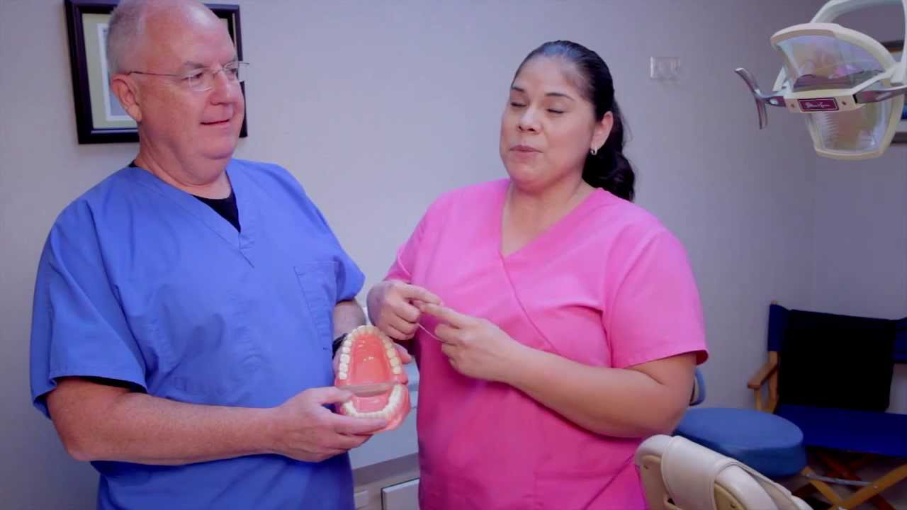 how to get something out of your teeth without floss
