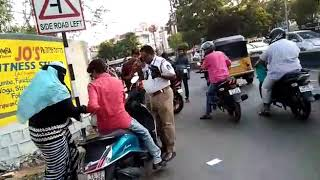Hyderabad Traffic police fights with woman rider by stopping vehicle