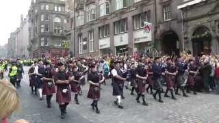 The Massed Pipes and Drums on the Royal Mile in Edinburgh thumbnail