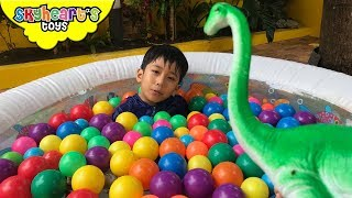 Ballpit of DINOSAUR TOYS! Skyheart searching for dinos in the pool trex long neck