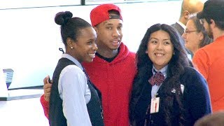 Tyga Loving The Attention As A Lady Magnet At LAX [2014]
