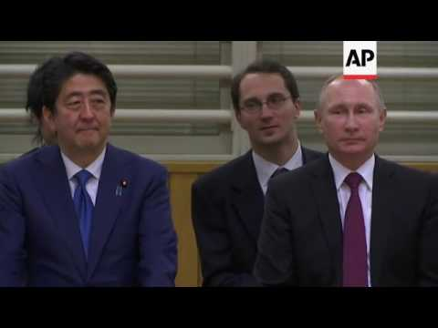 Raw: Putin Attends Judo Demonstration in Tokyo
