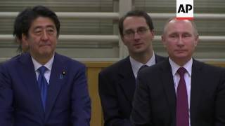 Raw: Putin Attends Judo Demonstration in Tokyo
