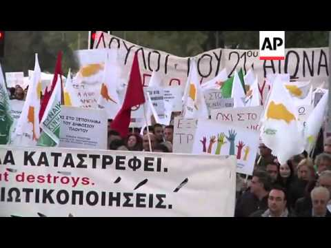 Cypriots protest terms of bailout deal to rescue the nation's banking system